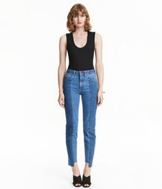 Denim blue. 5-pocket jeans in washed denim with panels in front, a regular waist, and dropped gusset. Slim, ankle-length legs with uneven, raw-edge hems.