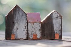 Little houses from recycled timber with copper roofs and doors by Jenny Walker.