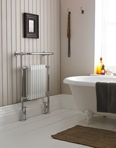 You really can't go wrong with a traditional heated towel rail! http://www.victorianplumbing.co.uk/Traditional-Savoy-Chrome-Heated-Towel-Rail-MTY022.aspx