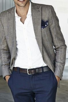 Consider pairing a grey plaid blazer jacket with navy blue trousers for a sharp, fashionable look.  Shop this look for $142:  http://lookastic.com/men/looks/pocket-square-longsleeve-shirt-blazer-belt-dress-pants/5142  — Navy and White Print Pocket Square  — White Longsleeve Shirt  — Grey Plaid Blazer  — Black Leather Belt  — Navy Dress Pants