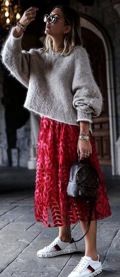 Red lace midi skirt with gray sweater.