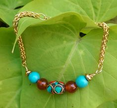 Coral and Turquoise Chain-link bracelet by MyOhmStyle on Etsy