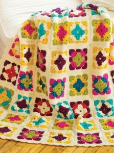 Embrace the bold shades of summer with the Watercolor Granny Square Blanket. This granny square pattern looks like a beautiful watercolor painting. | AllFreeCrochetAfghanPatterns.com