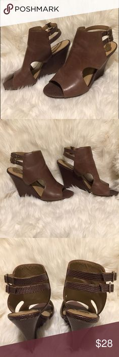Ann Taylor Leather Brown Peep Toe Wedges 8 Very nice Ann Taylor wedges! These are leather with Peep toe and cut out sides and a strappy sandal back! Cute and comfortable! Gently worn, some marks/scratches to leather but overall very good condition! Ann Taylor Shoes Wedges