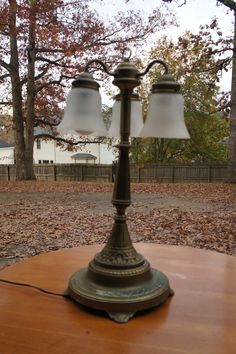 1920's Art nouveau art deco solid brass footed table lamp chandelier light fixture crackle glass shades three hanging bulbs by AriJaysEmporium on Etsy https://www.etsy.com/listing/496502821/1920s-art-nouveau-art-deco-solid-brass