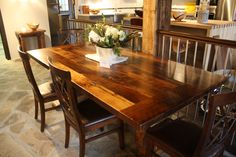 Reclaimed Wormy Chestnut Table with an epoxy finish. (Timber Barn)