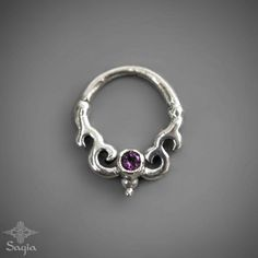 This unique handmade septum for a pierced nose made out of 925 sterling silver, beautiful and delicate tribal design, set with a beautiful Amethyst stone,