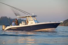 Everglades 295 Center Console in navy blue.
