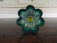dish flower I made, has a glass shot glass glued on the back, which fits over a pvc pipe to go into the yard
