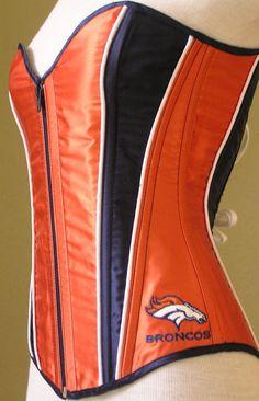 OOOOO!!!! Denver Broncos inspired zipper front navy and orange satin corset with navy cotton lining & Broncos logo. $250.00, via Etsy.
