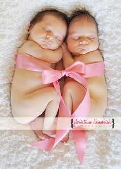 I'm not in love with uif whole naked baby pictures so I would definitely have clothes on them but this is a cute idea for twin photo shoot