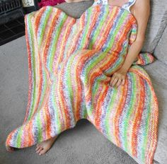 """Lovely Knitted throw/blanket that measures 47"""" X 44""""  Multi coloured.      As with all hand knitted items true measurements are difficult and each piece is individual so no 2 items will be exactly the same.        Wash at 30 degree on delicate cycle or hand wash. Dry flat, do not iron or tumble dry. Can be dry cleaned.          This item comes from a smoke and pet free home.   Shop this product here: http://spreesy.com/Knit2tog53/39   Shop all of our products at http://spreesy.com/Knit2tog53…"""