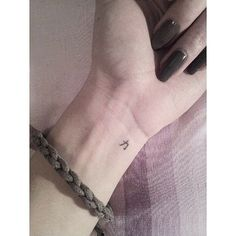 Teeny tiny wrist tattoo. The Chinese character for strength. Love!:
