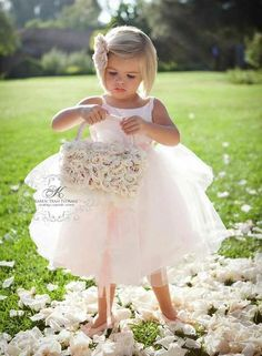 super cute flower girl in a pinkish white dress... yes please
