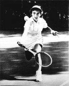 Photographer/Creator  Earl Seubert  Collection  1953  Publisher  Minneapolis Star & Tribune  Caption/Description  Woman tennis player getting ready to hit the ball.