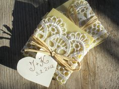 Wedding Favors- all natural Soaps Wrapped in Lace! Maybe my uncle and cousins could help me with this for a budget friendly alternative!! @Patrice Holodnick plauche what do you think?