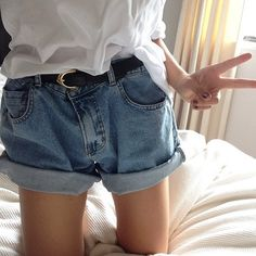 loose shorts held together with a belt, blouse knotted