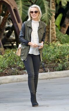 Julianne Hough pairs a feminine top with an edgy leather-sleeved jacket.