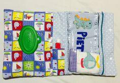 Porta lenço umedecido, pomada e fralda para o bebê
