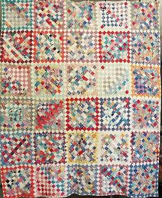 Beautiful and bright vintage postage stamp quilt made from feed sack fabrics
