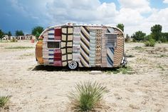 Yarn-bombed caravan at El Cosmico in Marfa, Texas. Photo by: John Huba Furniture Covers, Unique Furniture, Cheap Furniture, Everything Is Illuminated, Urban Graffiti, Yarn Bombing, Street Furniture, Land Art, Public Art