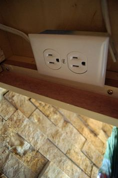 Hidden Outlets And Switches Are Installed Under Cabinets Instead Of  Directly On The Stone Backsplash.