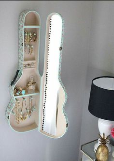 Guitar case jewelry cabinet