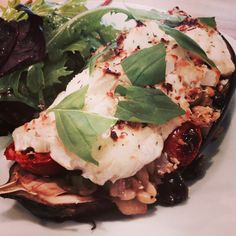 Melenzane ripiene Aubergine stuffed with mixed Mediterranean vegetables and topped with goats cheese and breadcrumbs.