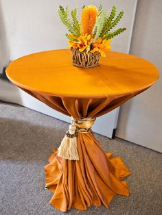 Amazing in Amber cocktail table- Amber Shantung is found in the middle of orange and yellow, with a dash of red. Your event will be dressed even better than your guests in these fashion inspired hue and texture. Cocktail Table Decor, Cocktail Tables, Wedding Linens, Wedding Chairs, Wedding Stage, Table Arrangements, Cake Table, Decoration Table, Table Linens