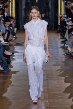 Mid-way, McCartney turned the eyelet into wide-leg trousers and cap-sleeved shirts and pretty little jackets. It was a cool way of taking something traditionally sweet and girlish and making it sporty and appealing to a different kind of crowd.   - HarpersBAZAAR.com
