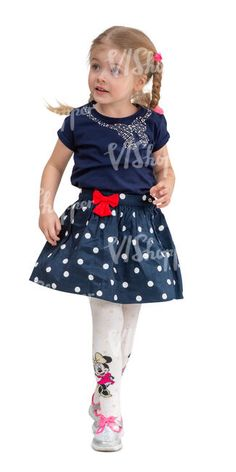 cut out little girl in a blue dress walking
