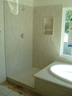 Corian Rain Cloud tub and shower surround. I want a solid surface tub surround. Easier to clean. NO GROUT!