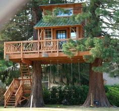 Now here is a tree house that has it all … even swings for the kids!