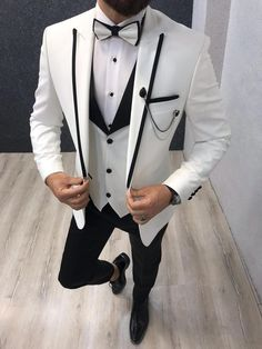 Collection: Spring – Summer 2019 Product: White SlimFit Tuxedo Color Code: White Size: Suit satin fabric, lycra Machine Washable: No Fitting: Slim-fit Package Include: Jacket, Vest, Pants Only Gifts: Shirt, Chain and Bow Tie Dry Clean Only Groom Tuxedo, Tuxedo For Men, Modern Tuxedo, Tuxedo Suit, Black Tuxedo, White Tuxedo Wedding, Tuxedo Colors, Slim Fit Tuxedo, Designer Suits For Men
