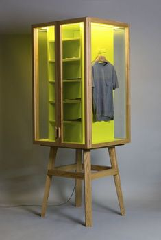 Work the yellow into wooden till panel Possible to put glass doors onto panel create a luxury cabinet feel?: