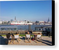 Relax On The Elbe Canvas Print by Marina Usmanskaya.  All canvas prints are professionally printed, assembled, and shipped within 3 - 4 business days and delivered ready-to-hang on your wall.  An unusually warm day on 15 October 2017 in Hamburg Germany. People relax on the Elbe embankment from the musical theater overlooking the San Pauli and Landesbrücken and the ship San Diego Museum  #MarinaUsmanskazaFineArtPhotography #HomeDecor #Hamburg