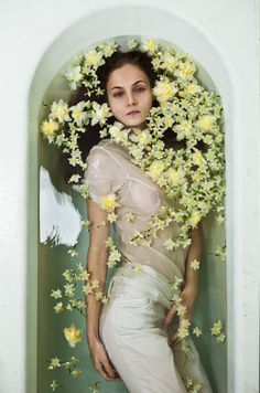 matias tronsco. Blending the line between 2D and 3D by using water, flowers and the model in a tub. Provides a nice arch form as well.