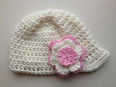Girls crochet newsboy cap with small peak and flower detail. Off-white cap with dusty pink and off-white flower. Other colours available. on Etsy, $18.00 AUD
