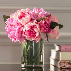 Craft a charming entryway vignette or dining table centerpiece with this lovely faux peony arrangement, showcasing pink blossoms nestled in a glass vase. Rosen Arrangements, Peony Arrangement, Peonies Centerpiece, Floral Arrangements, Pink Flower Centerpieces, Flowers Decoration, Tulip Bouquet, Peonies Bouquet, Rose Bouquet