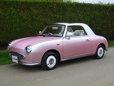 My dream car - the Nissan Figaro. Retro yet modern and oh so cute!