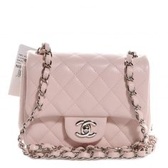 This is an authentic CHANEL Caviar Quilted Square Mini Flap in Light Pink - NEW. This chic baguette is crafted of textured diamond quilted leather.