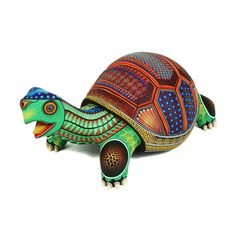 $695: Stunning turtle by artist Jesus Sosa Santiago.Jesus is only 20 years old and already is creating superb quality wood carvings. He started carving when he was 12 and credits his brother in law, Agustin Cruz Prudencio for influencing and perfecting his style. The quality of his <strong>painting</strong> is <strong>impressive</strong>…so detailed, precise and clean. The coloring very attractive. A new Oaxacan artist to follow closely!