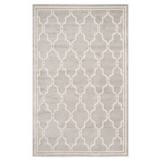 Featuring a quatrefoil trellis motif in light grey and ivory, this eye-catching loomed rug adds a pop of pattern to your living room or master suite.  ...