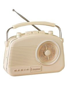Known as the Baby Brighton, this Cream Portable AM/FM retro radio comes with push button band selection and rotary dials for tuning, on/off, volume and tone controls. Classic ultra-compact design with AUX-in and Headphone Socket.