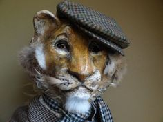 Animal head mask paper mache lion* mask by MiesmesaBerni (Viewer comment:  could be a tiger also......)