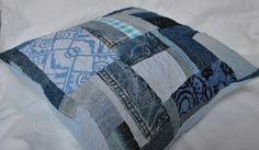 Blue denim patchwork cushion, machine embroidered, via Etsy.