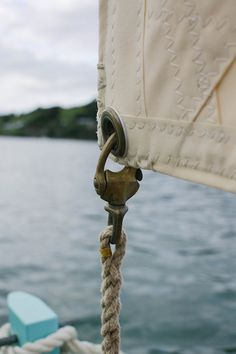 "An Ilur in Ireland - I got all the traditional fittings from www.classicmarine.co.uk. This is a 3 1/4"" bras snap shackle. It is indispensable when reefing, you don't want to be trying to undo bowlines or pin shackles in a blow!"