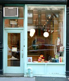 I want a muffin shop with a storefront like this. I love a big, open window. Maybe not the blue.