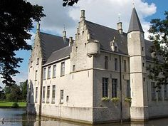 Cortewalle Castle (Dutch: Kasteel Cortewalle) is a moated castle in Beveren in East Flanders, Belgium. The castle dates back to the 15th century, and is one of the oldest in the Waasland. It is built of white sandstone, in Flemish Renaissance style.