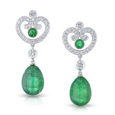 AURORA EMERALD DROP EARRINGS  The crisp rococo openwork white gold scrolls of the distinctively feminine Impératrice design immaculately set throughout with white diamonds, enclosing superb quality emeralds, create a striking contrast of colour and light. These earrings are finished with luscious and sensual tassel of intense color emerald beads. A pair of earrings fit for an Empress.     This piece is set in platinum and features round white diamonds and egg-shaped emeralds.